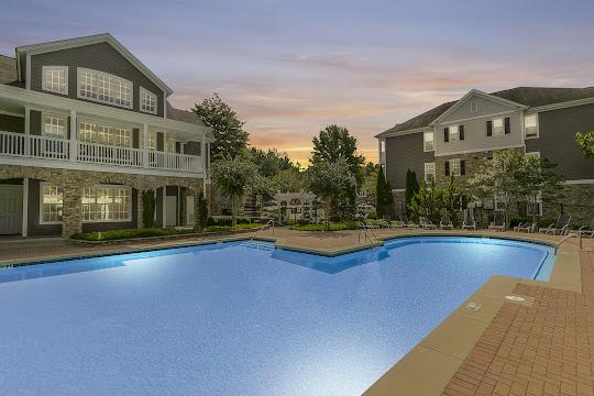 Oakwood Vista's refreshing swimming pool at dusk