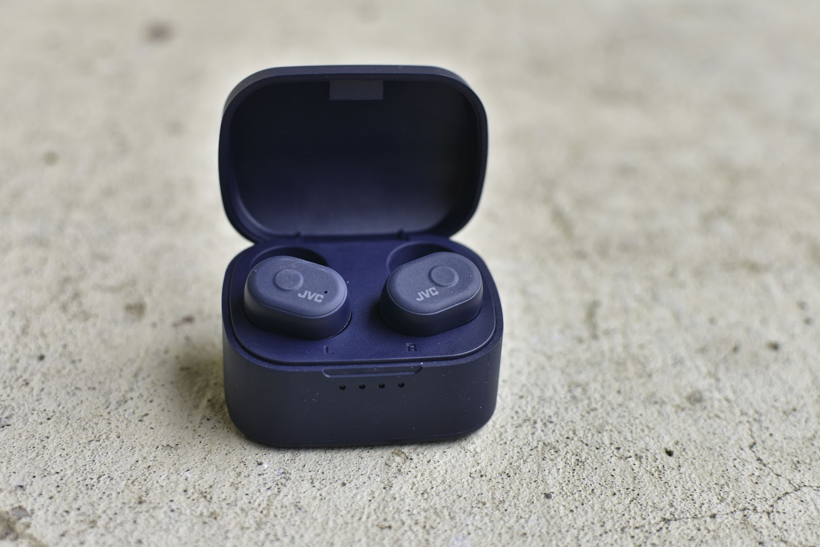 JVC HA-A10T headphones outside of the box and in their charging case