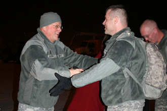 Photo: State Adjutant General Larry W. Shellito greets Soldiers from the 34th Infantry Division as they arrive from Ft. Lewis at the 133rd Airlift Wing on February 5, 2010 after spending nearly a year deployed to Iraq in support of Operation Iraqi Freedom.