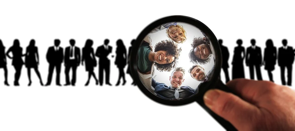 A group of people in a magnifying glass, representing buyer personas for an e-commerce store