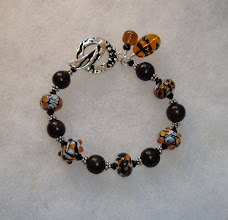 Photo: lampwork and wood bracelet