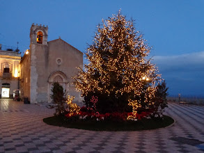Photo: Piazza Sant'Agostino, public library behind the tree