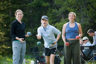 Photo: young women playing bocce ball while camping on Jackson Lake. Grand Teton NP, WY