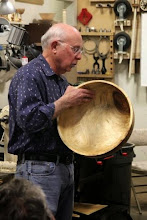 Photo: Show Tell & Ask Leader, Bill Long, holds and discusses Bob Grudberg's large and impressive bowl.