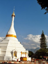 Photo: White stupa on the top of the hill