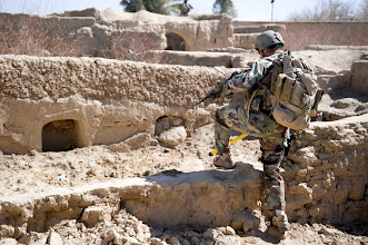 Photo: A U.S. Special Forces intelligence sergeant assigned to Special Operations Task Force – South climbs over the ruins of an abandoned compound during a security patrol Feb. 20, 2011 in Panjwai District, Kandahar Province, Afghanistan. The SOTF-South Special Forces team in the area conducts regular patrols in order to secure known abandoned compounds from the possible storage of explosives making material.    (U.S. Army photo by Sgt. Ben Watson)(Released).