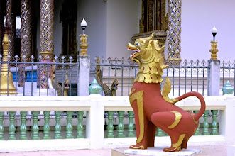 "Photo: a happy mythical ""singh"" lion guarding one of the corners of the chedi at Wat Hua Wiang"