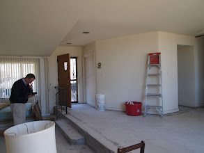 Photo: Dining/Living Room and Front Door (before)