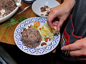 Photo: arranging accompaniments by the mounded fried rice