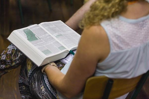 Leonie Oudijk reads her Dutch Bible.