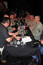 Photo: Minnesota National Guard Soldiers and Croatian Soldiers dine side-by-side at Cabin Fever restraint in Little Falls, Minn. July 14.  The Croatian soldiers are taking part in the Department of Defense's Partners for Peace program with 2nd Battalion, 136th Combined Arms Battalion at Camp Ripley, Minn.(Camp Ripley photo by 1st Lt. Kenneth R. Toole)(Released)