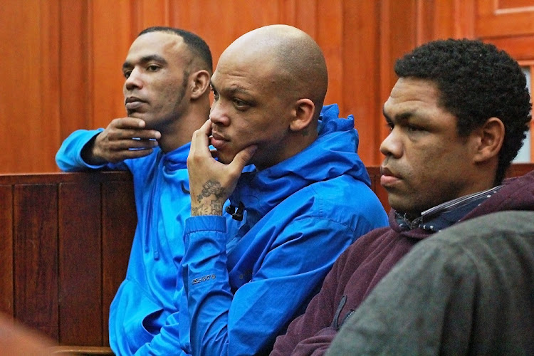 Vernon Witbooi, Geraldo Parsons and Eben van Niekerk in court on judgement day in the murder trial of Hannah Cornelius. The three men have been accused of murdering and raping Cornelius.