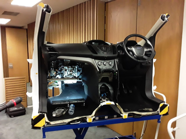 The front of a Ford Kuga in the Cape Town high court. On the left is the area above the passenger seat footwell where police and forensic experts believe the fire that killed Reshall Jimmy broke out.