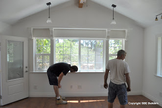 Photo: Brian and Lance checking the base board painting.