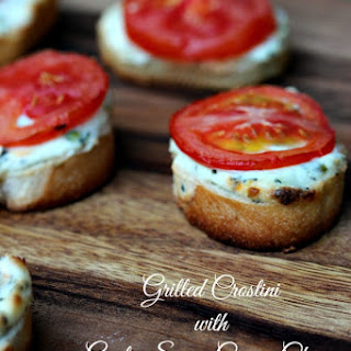 Grilled Crostini with Garlic Scape Cream Cheese and Tomatoes