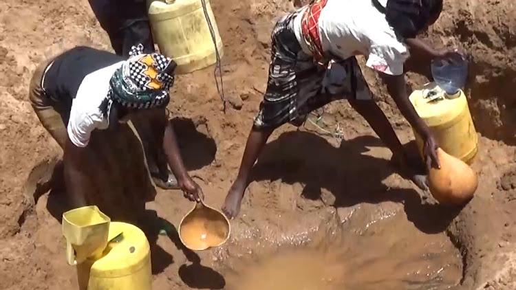 Kyalamoko residents in Nguni ward fetching muddy water at River Enziu, 20 kilometres from their homes.
