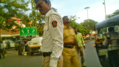 "Photo: ""Wish you a Happy Dusera!"", a handsome police officer in front of Pune station. I named him ""Mr. Dabangg (http://www.imdb.com/title/tt1620719/)"" 3rd October updated (日本語はこちら) - http://jp.asksiddhi.in/daily_detail.php?id=662"