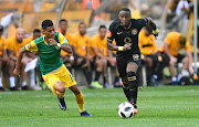 Seth Parusnath of Lamontville Golden Arrows pushes hard to put pressure on George Maluleka of Kaizer Chiefs FC during the Absa Premiership 2019/20 game between Golden Arrows and Kaizer Chiefs at Moses Mabhida Stadium in Durban on 25 January 2020.
