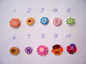 """Photo: Flower Canes. $3.50 per inch long with a Diameter = 1/2"""" inch around Daisies: 1. Orange, 2. Yellow, 3. Turquoise, 4. White with Alizarin Crimson out, 5. Green. 6. Yellow Sunflower, 7. Purple Violet, 8. Pink Aster, 9. Brown, orange and yellow Pansy, 10.Purple, Fuchsia and brown Pansy."""