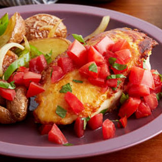 Parmesan Crusted Chicken Breasts with Tomato and Basil and Potatoes with Peppers and Onions.