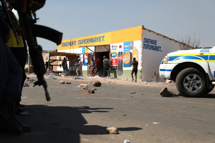 Police are monitoring the situation in White City following attacks aimed at foreign owned shops in the township.