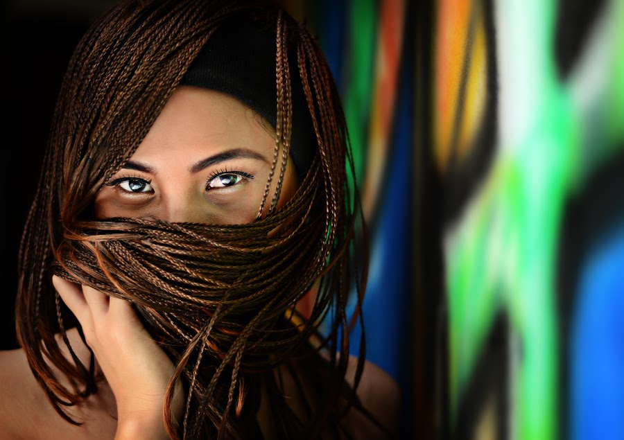 mischief by Annabell  Beldua - People Portraits of Women ( braided hair, wall paint, shy woman, smile )