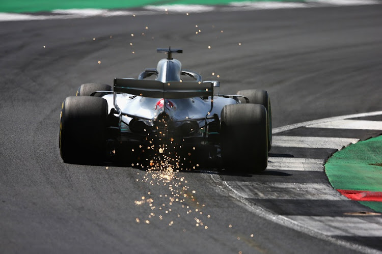Sparks fly behind Lewis Hamilton of Great Britain driving the (44) Mercedes AMG Petronas F1 Team Mercedes WO9 on track during final practice for the Formula One Grand Prix of Great Britain at Silverstone on July 7, 2018 in Northampton, England.