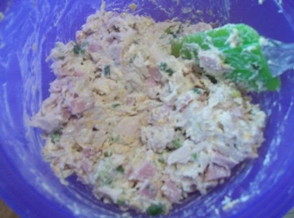 Cook chicken in water, drain, chop medium pieces.  Chop ham into medium pieces.   In a...