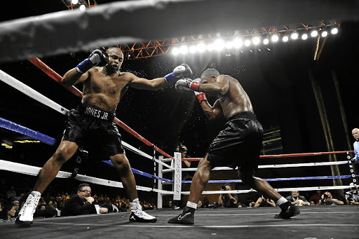 Roy Jones jnr battles Eric Watkins during their heavyweight bout at the Foxwoods Grand Theater in Mashantucket, Connecticut.