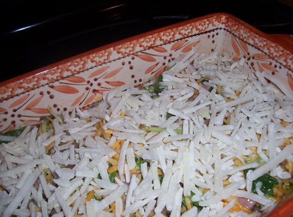 After bread bcomes browned pour egg mixture over it and top with 1/4 shredded...