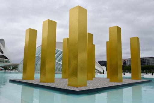 Golden pillars highlight a work of public art in Valencia, Spain.