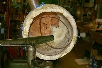 "Photo: Turning the maple bowl, imbedded walnut rings, and foam!  All I can say is ""Wow!""  Remove the foam, and you get..."