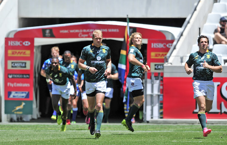 Philip Snyman of South Africa leads his team out against Fiji during day 2 of the 2017 HSBC Cape Town Sevens at Cape Town Stadium on 10 December 2017.