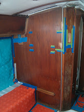 Photo: tape marking areas in bulkhead that need holes filled or gouges filled