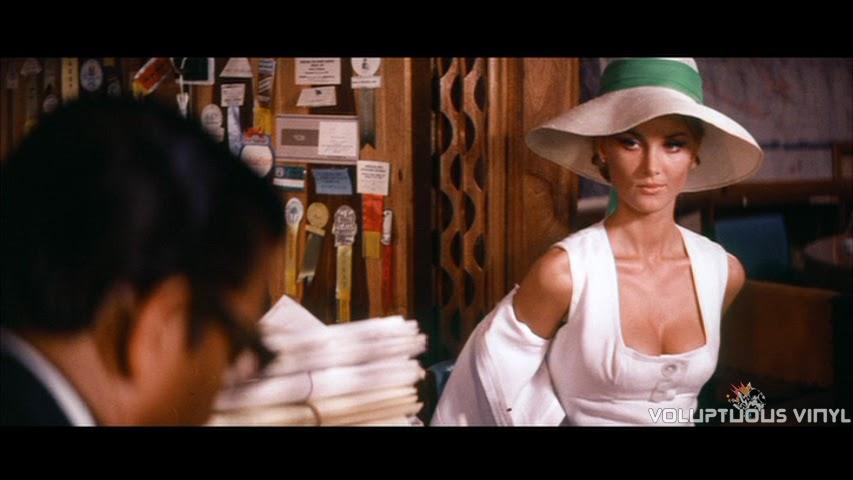 Barbara Bouchet seductively removing her coat in Stoney.