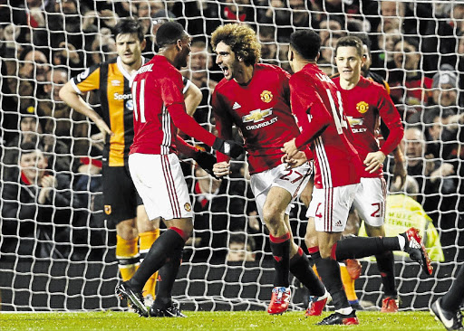 LET THE GOOD TIMES ROLL: Manchester United's Marouane Fellaini celebrates their second goal against Hull City in the EFL Cup semifinal first leg at Old Trafford on Tuesday.