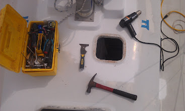 Photo: Thankfully the screws retreated easlily.  I used a heat gun, scraper, and hammer to free the hatch from the 5200.tge