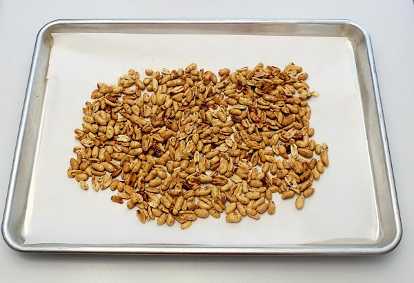Peanuts cooling on a baking sheet.