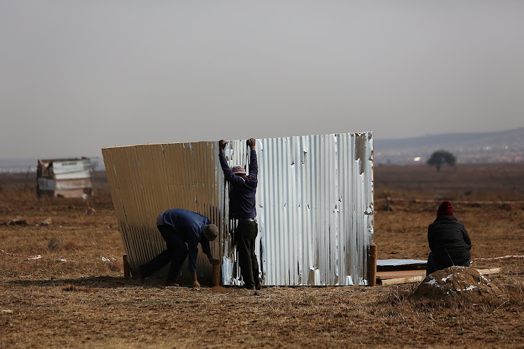 People occupy an empty piece of land and build shacks on it. At the same time residents of Lawley south of Johannesburg barricaded roads in the area, vowing to place the community on lockdown.