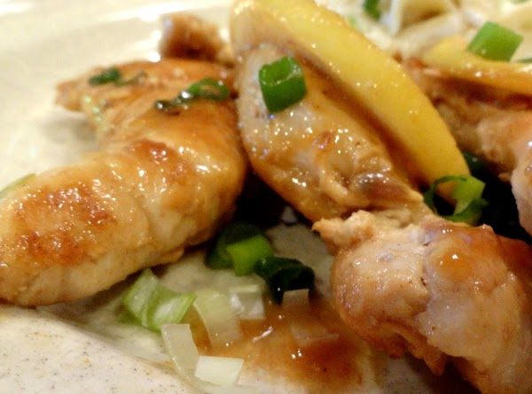 Drizzle the sauce over the warm chicken tenders and sprinkle with the green onions.