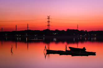 Photo: Boats sit idle in the waters of Lake Teganuma in Chiba Prefecture, Japan
