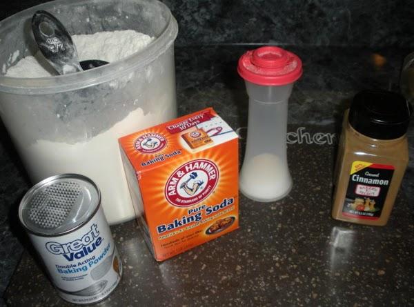 Preheat oven to 350 degrees.  Mix together dry flour, baking powder, baking soda,...