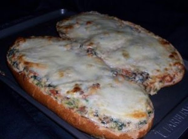 This is what it looks like with Mozzarella cheese, cooked on top, for 7 min, before taking out of the oven, (my husband prefers cheese, lots of cheese, this is the one i made tonight (04/26/12)
