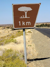 Photo: Very common road sign - one kilometer to the resting place