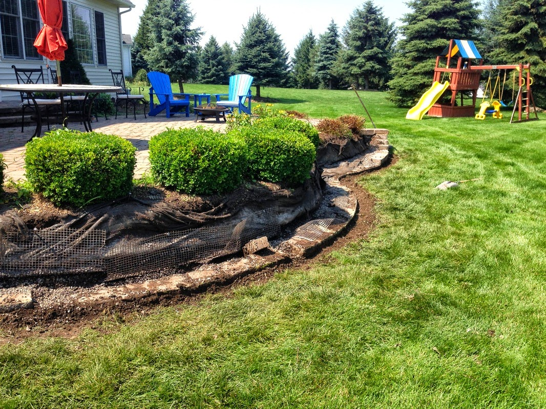 Photo: Retaining Walls Construction & Repair Sevices in Rochester, Monroe County NY  Retaining Walls Construction & Repair Sevices in Rochester, Monroe County NY by Acorn Ponds & Waterfalls.   Check out our website www.acornponds.com and give us a call 585.442.6373.  The installation requirements for retaining walls in Rochester, Monroe County, New York will vary depending on what type wall block, how high you are going, what is going to be held back or retained and what the area that is retained is going to be used for. It is very important to build retaining walls by recommended guidelines of the manufacturers.  Visit our website info on Retaining Wall Repair & Construction here: http://www.acornponds.com/retaining-walls.html - in Rochester NY  Learn more about Retaining Wall Repair, Renovation & Construction in the Pittsford, Brighton, Fairport, Penfield, Irondequoit and more in The Greater Rochester New York (NY) Area: https://www.facebook.com/notes/acorn-ponds-waterfalls/retaining-walls-repairsbrick-wall-installation-renovation-rochester-monroe-count/755282901175501  Find us on Houzz here: www.houzz.com/pro/acornlandscapedesign/acorn-landscaping-and-ponds-llc  Click here for a free Magazine all about Ponds and Water Features: http://flip.it/gsrNN   Sign up for your personal  design consultation here: www.acornponds.com/contact-us.html   Acorn Ponds & Waterfalls   585.442.6373 www.acornponds.com