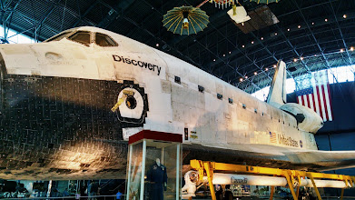 Photo: The Canadarm, a space crane, rests next to the Space Shuttle Discovery.