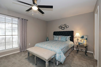 The Venice model floorplan bedroom with carpet and ceiling fan