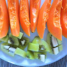 The row of papaya and some kiwi by Svetlana Saenkova - Food & Drink Fruits & Vegetables ( orange, papaya, kiwi, orange fruit, row, tasty, fresh, breakfast,  )