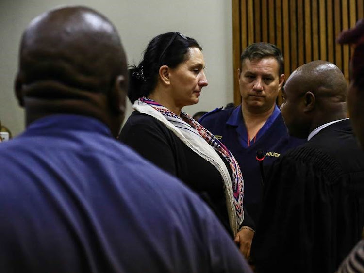 Vicki Momberg is back behind bars after handing herself over to police.