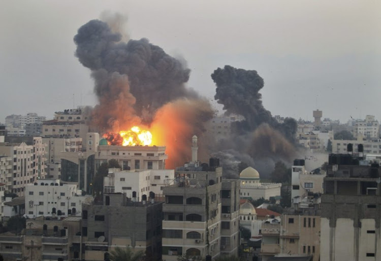 Smoke and explosion are seen after Israeli air strikes in Gaza City. Picture: REUTERS